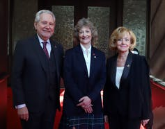 Sen. Patricia Duncan poses for a photograph with Sen. Raynell Andreychuk  and Sen. Peter Harder outside the Senate Chamber.
