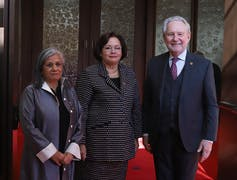Sen. Rosemary Moodie (centre) poses for a photograph with Sen. Ratna Omidvar and Sen. Peter Harder outside the Senate Chamber.