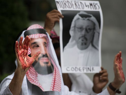 A demonstrator dressed as Saudi Arabian Crown Prince Mohammed bin Salman with blood on his hands protests outside the Saudi Embassy in Washington, DC, Oct.  8, 2018.