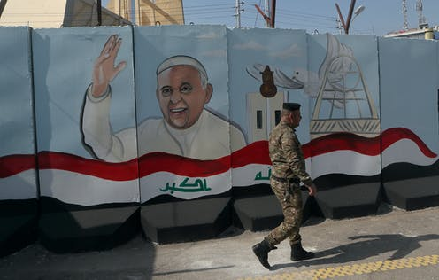A mural depicting Pope Francis, Baghdad, Iraq
