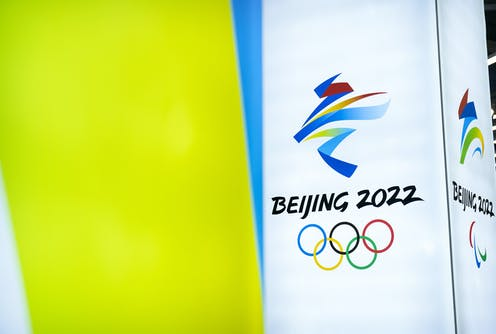The logo for the Beijing 2022 Olympics is displayed at a venue