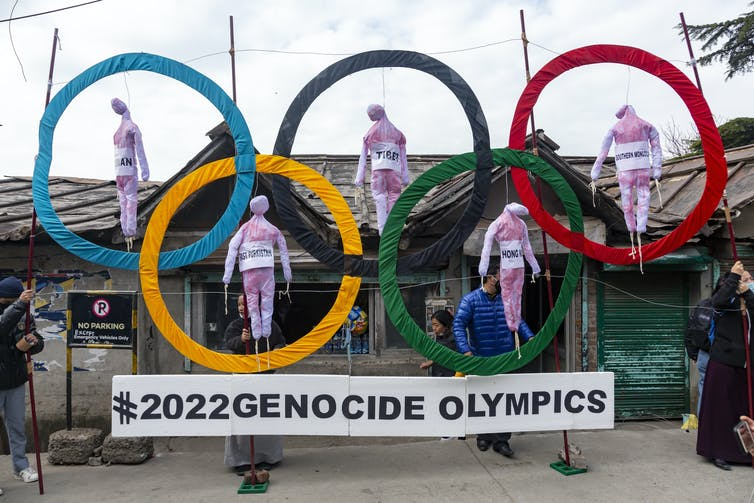 Effigies hang within the five rings of the Olympic logo