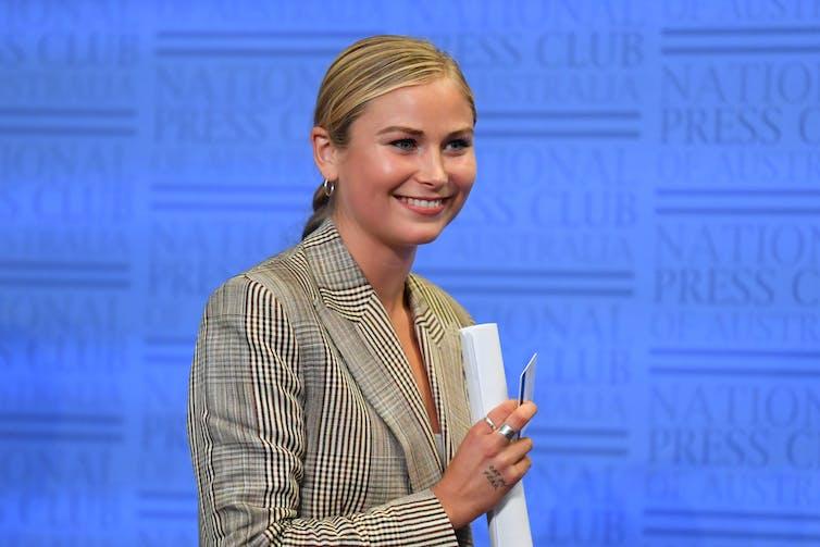 young blonde woman at National Press Club podium