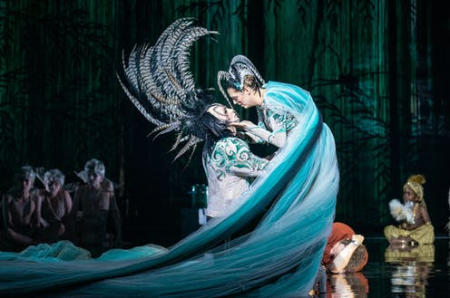 Production image: two characters embrace