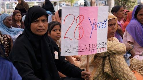 Protesta para exigir responsabilidades por el desastre de Bhopal (India). Bhopal Medical Appeal / Flickr, CC BY-NC