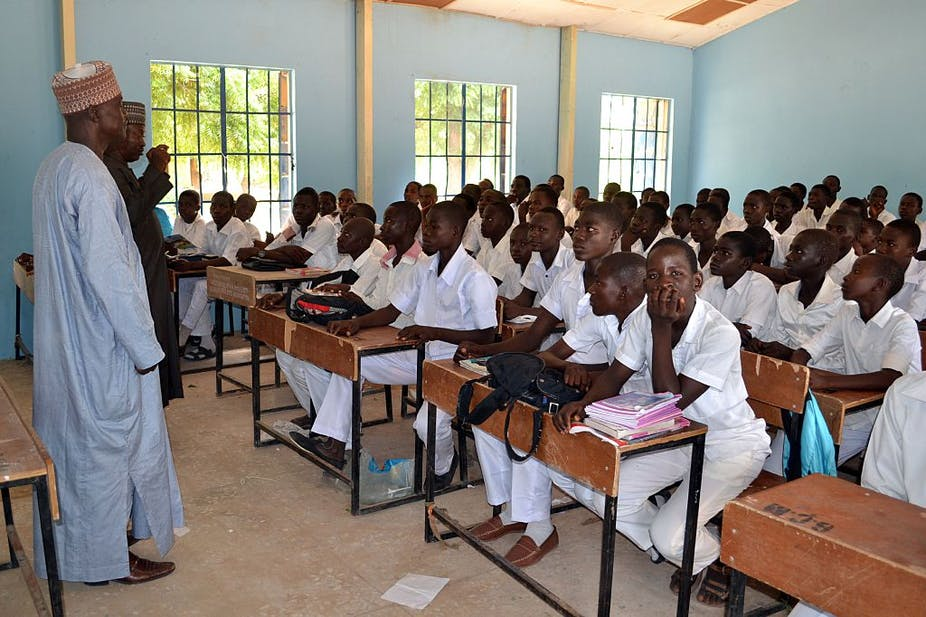 Students listening to a lecture in a classroom.