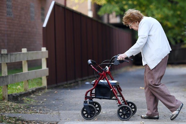 Elderly woman going for a walk.