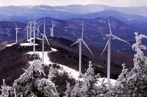 Wind turbines on a snowy ridge in Maine, February 2021