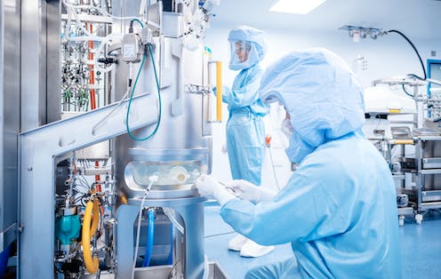 Vaccine developers working at a BioNTech facility.