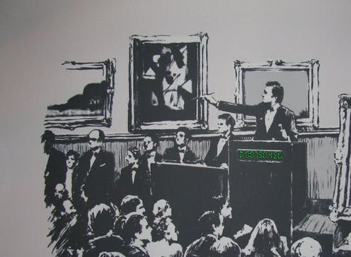 """A piece of artwork by Banksy, showing an auction room with a painting of the words """"I can't believe you morons actually buy this shit"""" on it."""