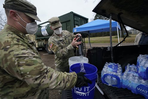 National Guard members supplying water during a disaster