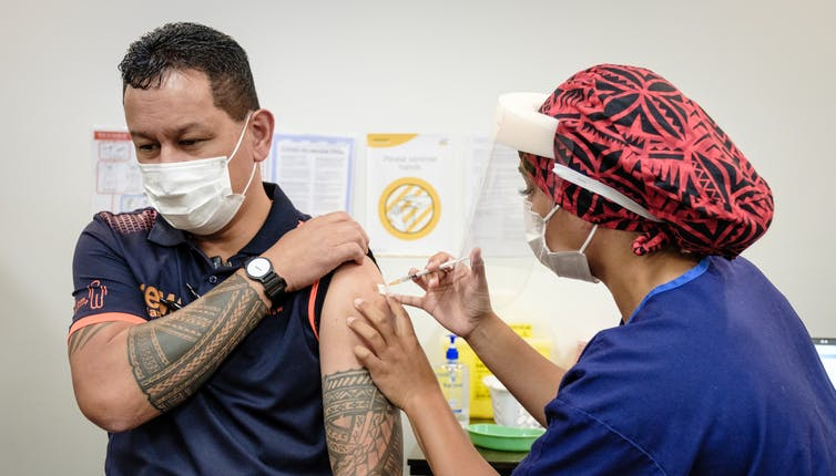 A nurse administering a COVID-19 vaccination