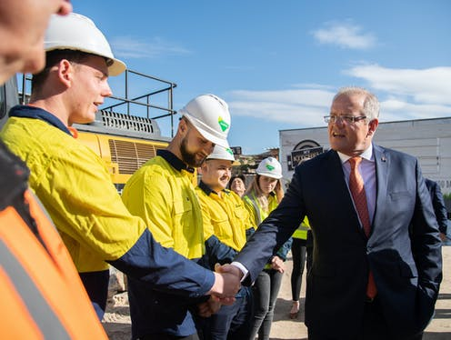 Scott Morrison shaking the hand of a construction worker