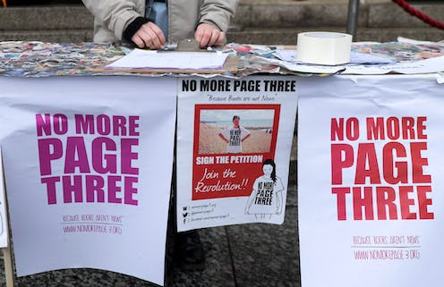 Posters and a petition at a stall for the 'No More Page Three' campaign.