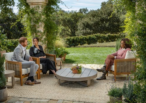 Meghan Markle and Prince Harry are interviewed in a garden.