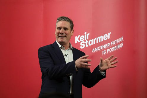 Keir Starmer speaking in front of a sign reading 'Another Future is Possible'.