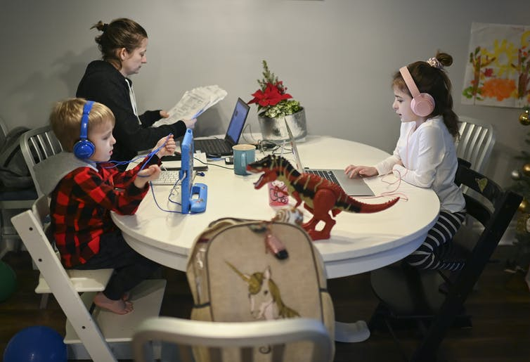 A family working at a table.