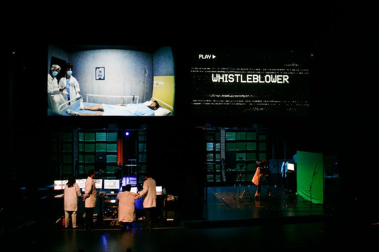 A full stage shot showing the technology and multiple screens.
