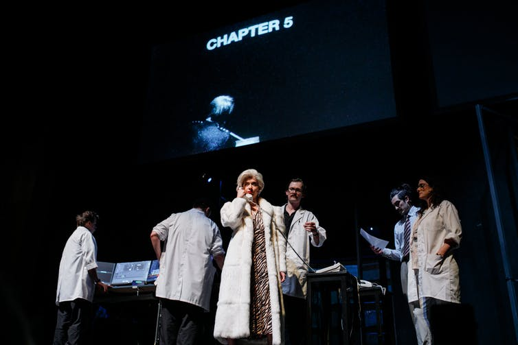 The cast in white lab coats.