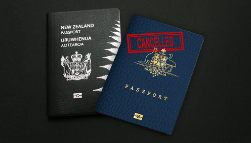 A New Zealand passport and an Australian passport that is marked cancelled.