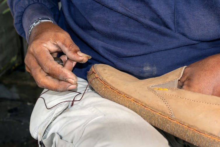 Man fixes shoe