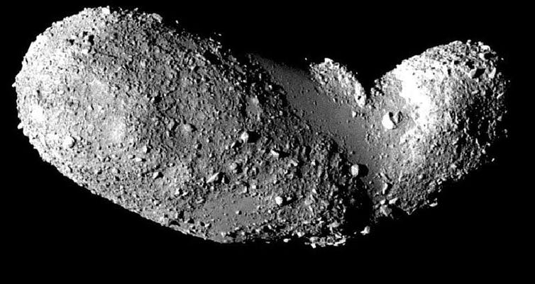 A rocky asteroid against a black background
