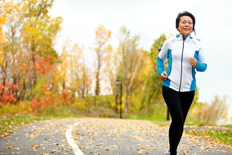 Woman running outdoors in the autumn.