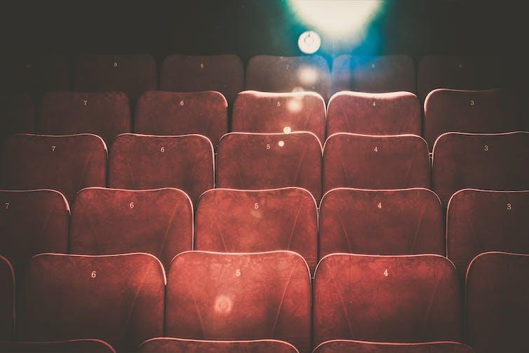 Empty cinema seats in a theatre.