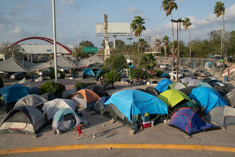 Dozens of tents in a parking lot