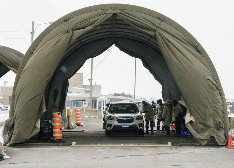 A car stops at a border crossing