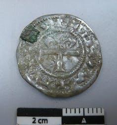 A 4cm-wide worn silver coin.