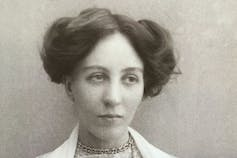 A black-and-white portrait of a woman