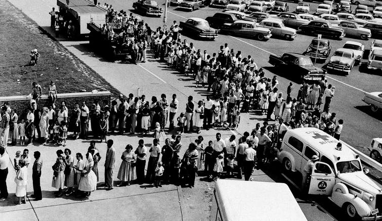 A long line of people waiting for polio vaccines in Illinois in 1959
