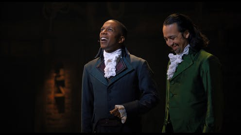 Two characters from Broadway show Hamilton stand together onstage