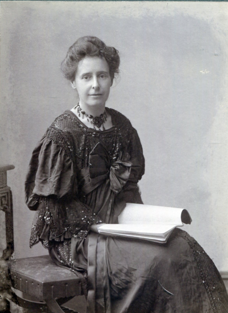 A woman sitting with a book on her lap