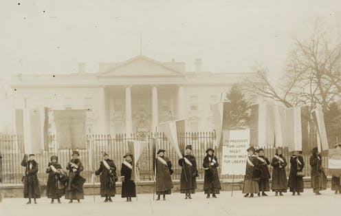Women protest outside the White House