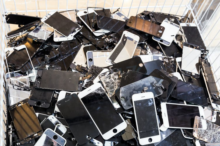 Pile of smashed, discarded smartphones