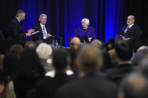 Janet Yellen, Ben Bernanke and Jerome Powell sit on a stage together
