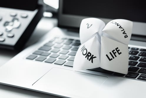 Origami fortune teller on laptop depicting options of work or life or balance.