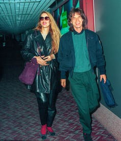 Jerry Hall and Mick Jagger walking together in 1993