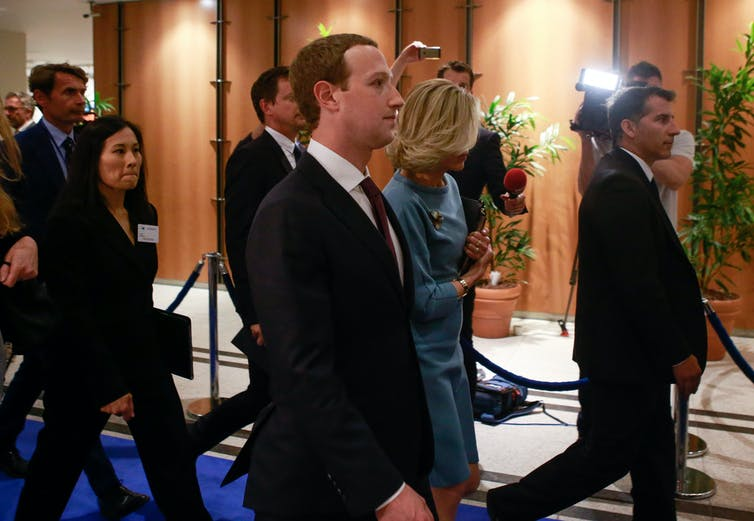 Mark Zuckerberg leaving a hearing after appearing before European Parliament