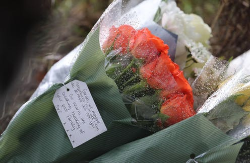 A bunch of roses in wrapping paper with a note addressed to Sarah Everard who went missing in London on March 3.