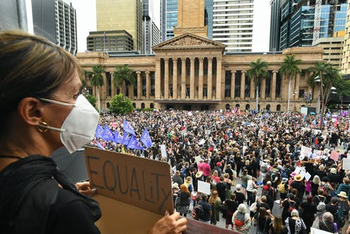 Women rally at the March 4 Justice protest in Brisbane.