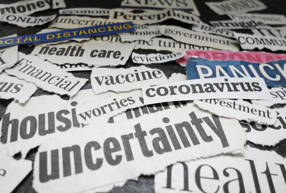 Newspaper headline words cut out relating to covid