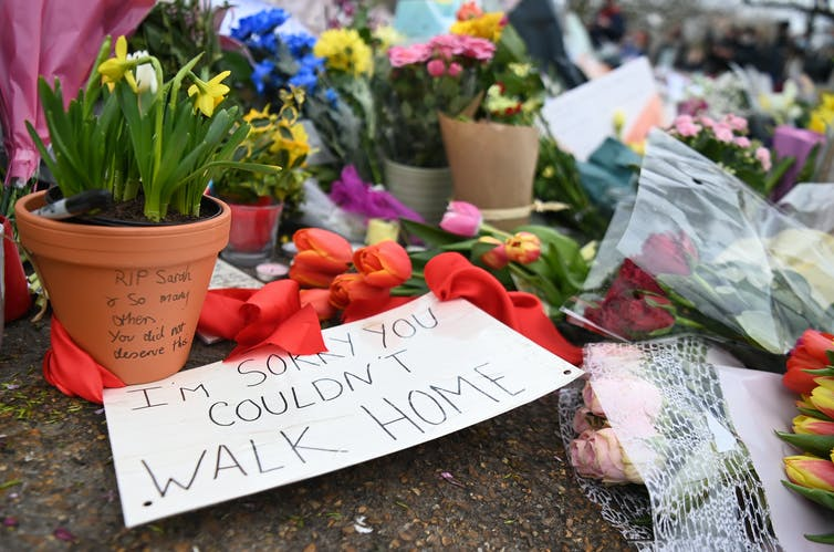 A sign left at the memorial for Sarah Everard reads: