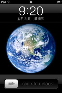 Screenshot of an iPod showing an image of the earth and the slide-to-unlock bar