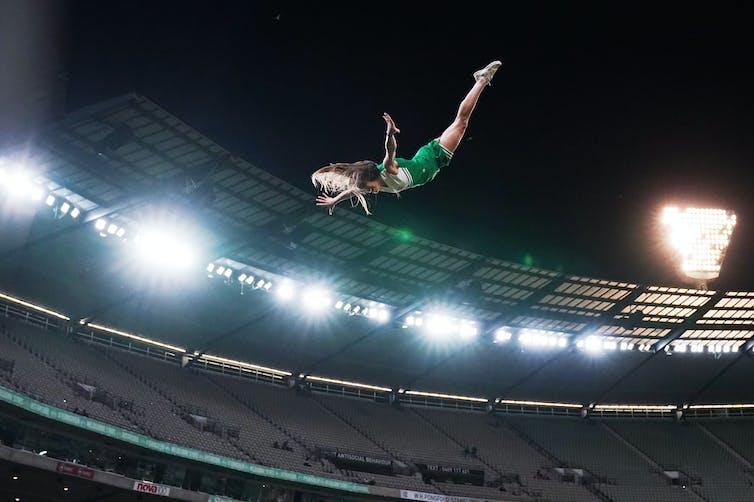 A cheerleader flies through the air