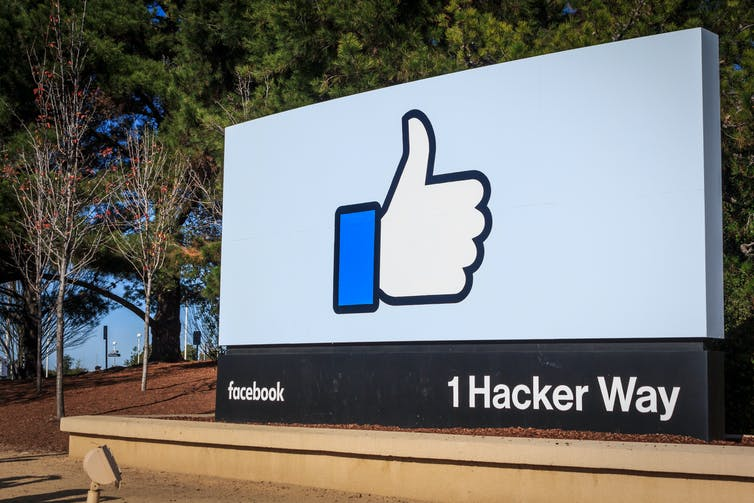 Billboard with the thumbs-up icon at Facebook HQ in Menlo Park, California.