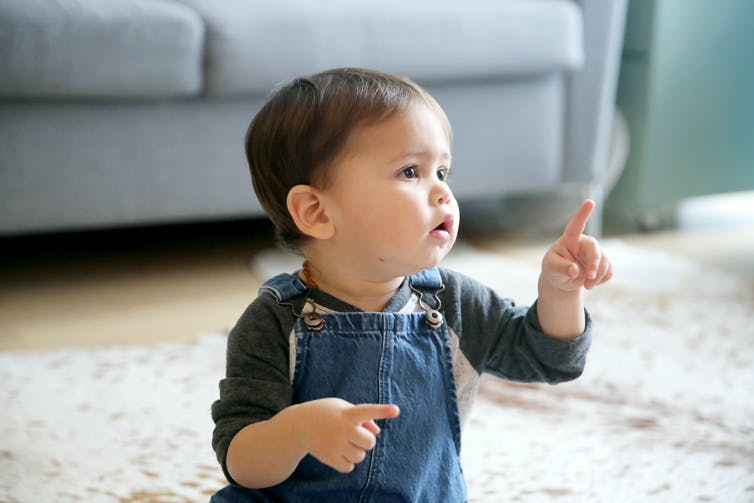 A child raises a finger