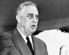 FDR speaks in a black-and-white photo.